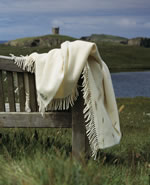Vaila organic wool blanket on a bench